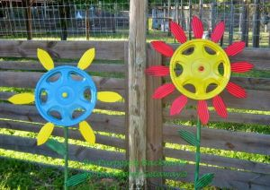re-purposed backyard blog hubcap daisy